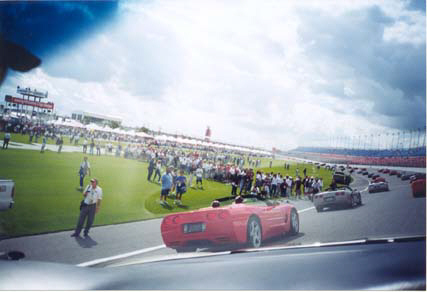 Race crews come out to see the endless parade of Corvettes